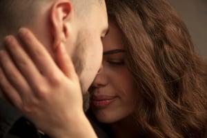 Man and woman embrace forgiveness