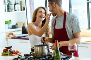 Couple have a date night in. Great ideas for having a home date with spouse