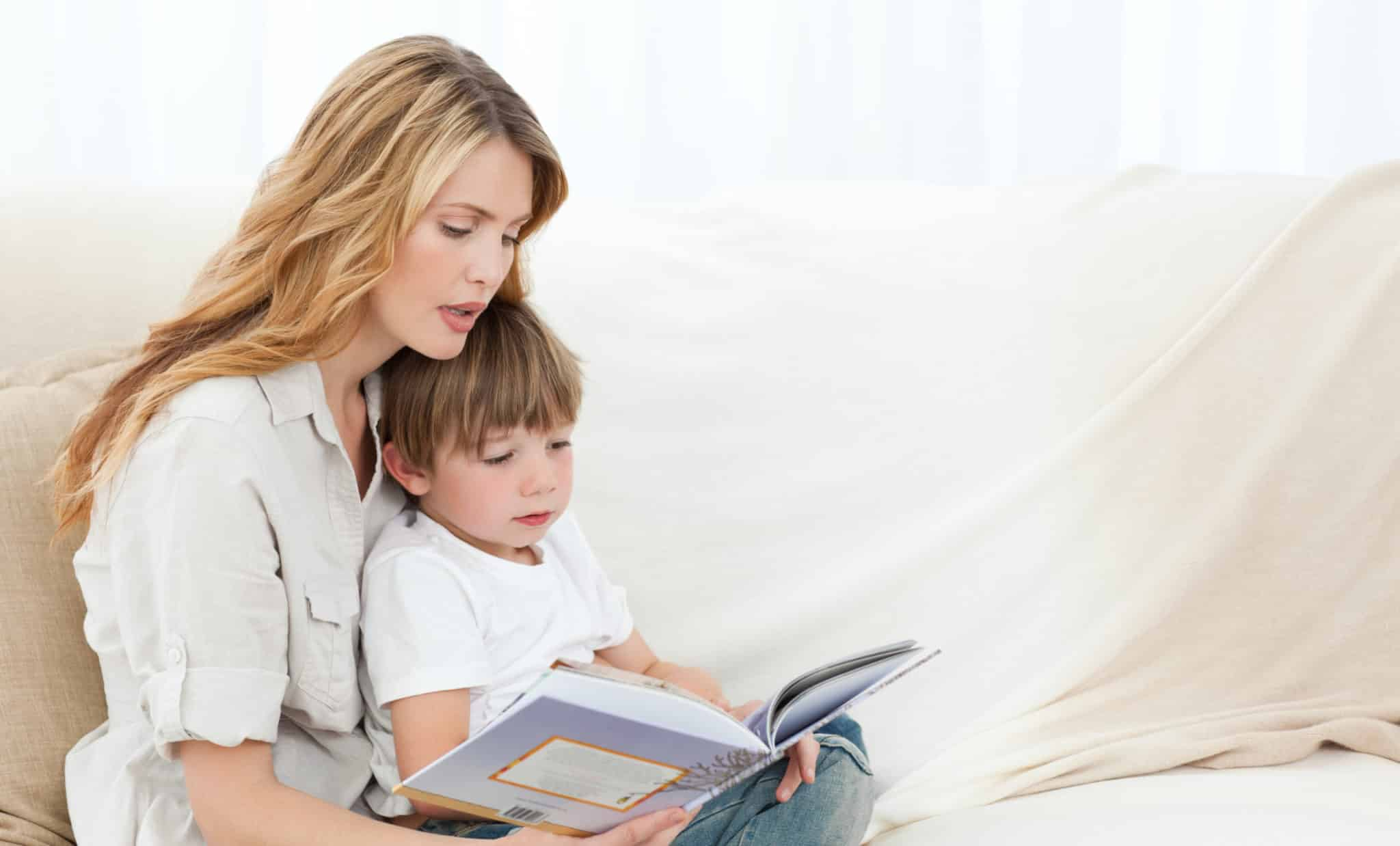 mother reads to a child to help build his language development