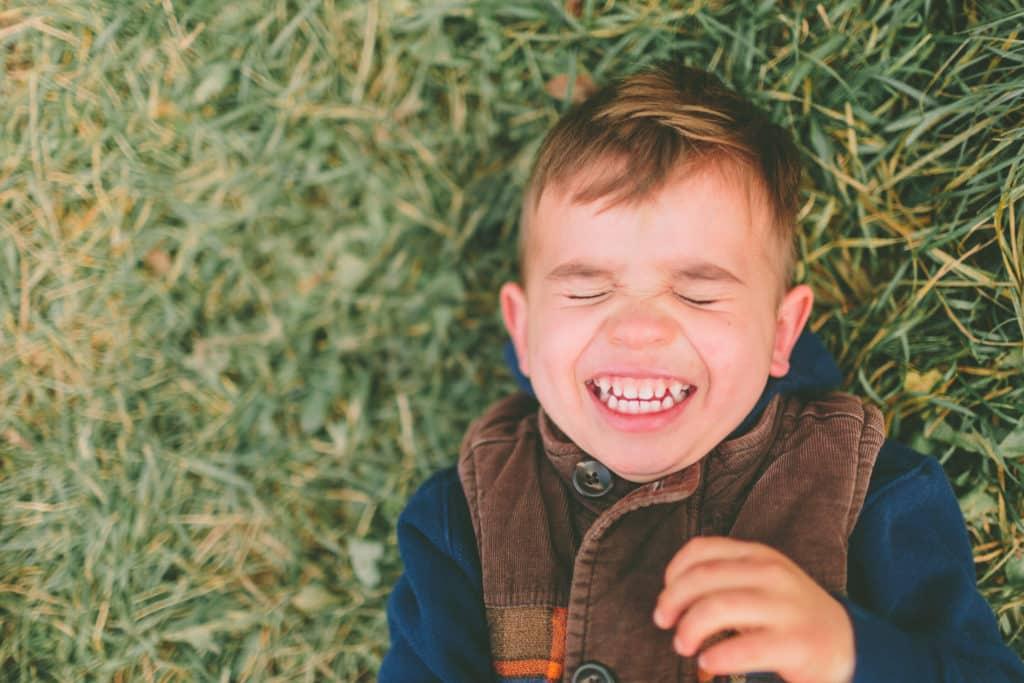 Boy lauging: ADHD children have uninhibited emotions